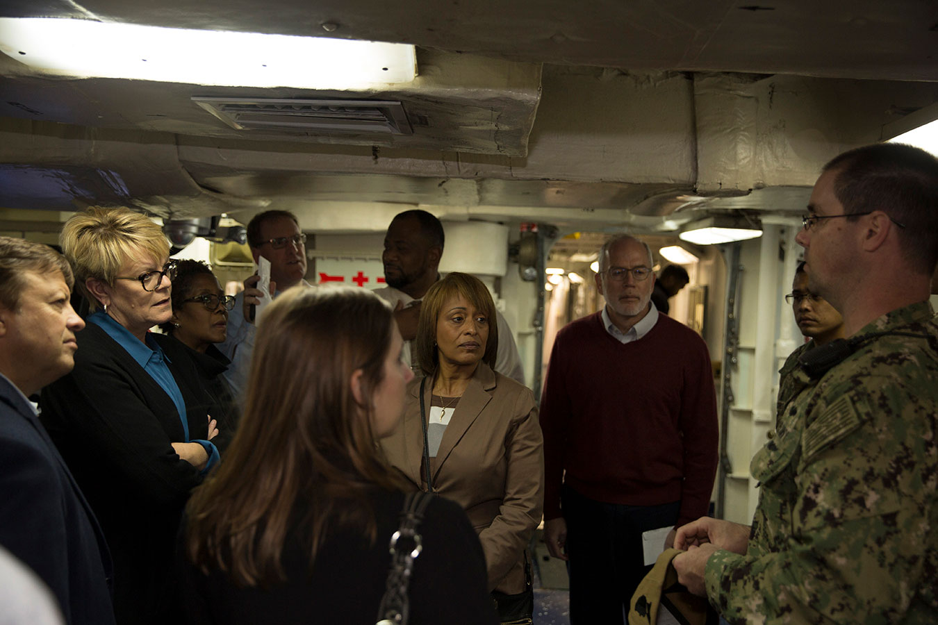 Fiscal Service staff and Navy personnel inside ship